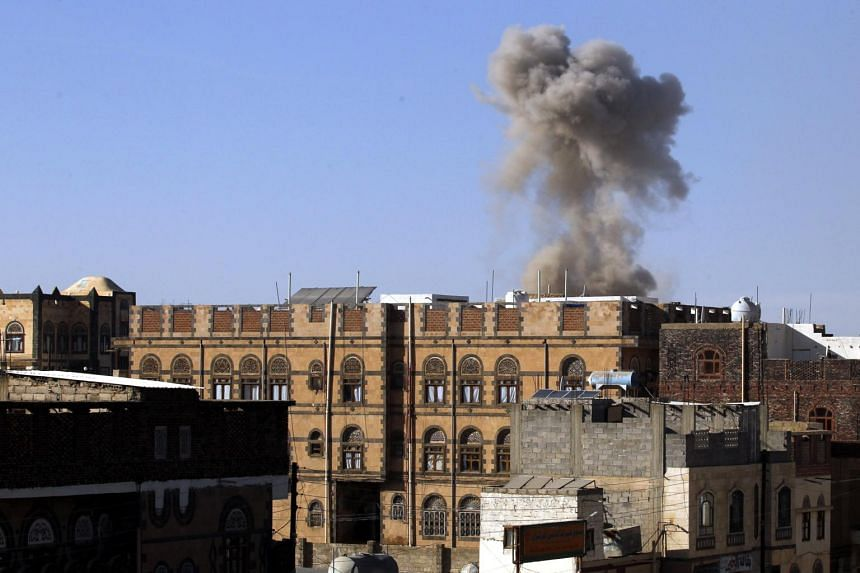 Smoke billows above a neighbourhood following an alleged Saudi-led airstrike in Sana'a, Yemen, on Nov 5, 2017.