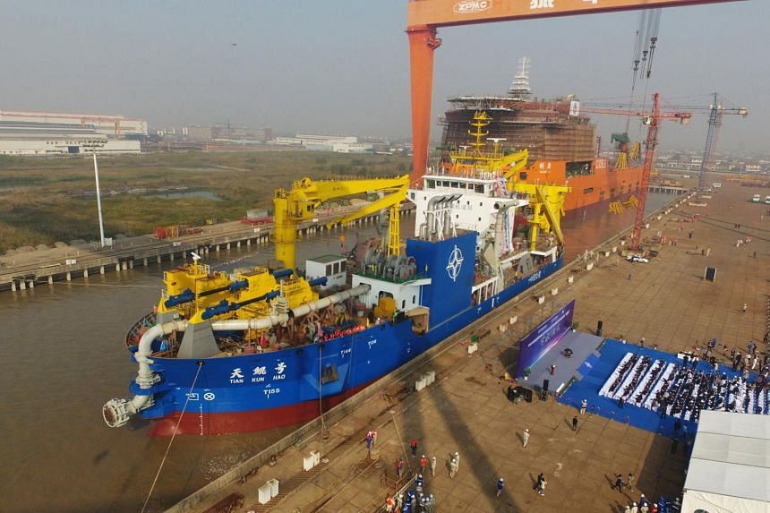 Military officials said the ship, Tian Kun, had a deck the size of nine basketball courts and would become Asia's largest dredging vessel.