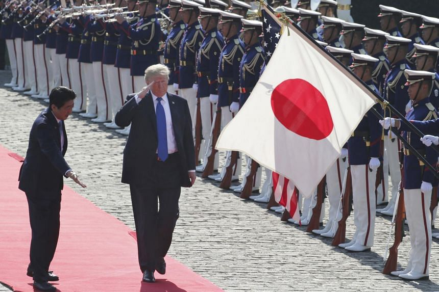 Japan was hit by a rare string of bomb threats as US President Donald Trump held talks in Tokyo, kicking off an Asia tour under heavy security.