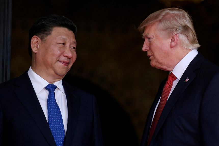US President Donald Trump welcomes Chinese President Xi Jinping at Mar-a-Lago state in Palm Beach, Florida, on April 6, 2017