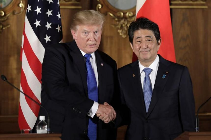 US President Donald J. Trump shakes hands with Japan's prime minister Shinzo Abe during a news conference at Akasaka Palace in Tokyo, Japan, Nov 6, 2017. President Trump's visit to Japan is the first stop of his 12-day tour of Asia. After Japan, Trum