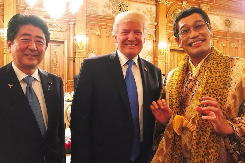 Japanese internet sensation Pikotaro, whose real name is Kazuhito Kosaka, posted photos with US President Donald Trump and Japanese Prime Minister Shinzo Abe on his official Facebook page on Nov 6, 2017.