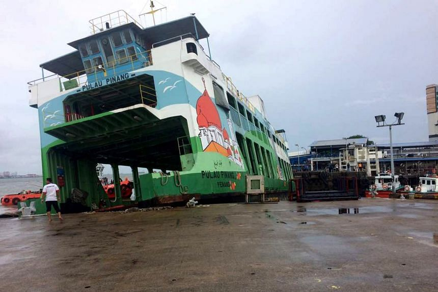 A ferry washed ashore amid strong winds brought on by the storm yesterday in Butterworth, the main town of mainland Penang.
