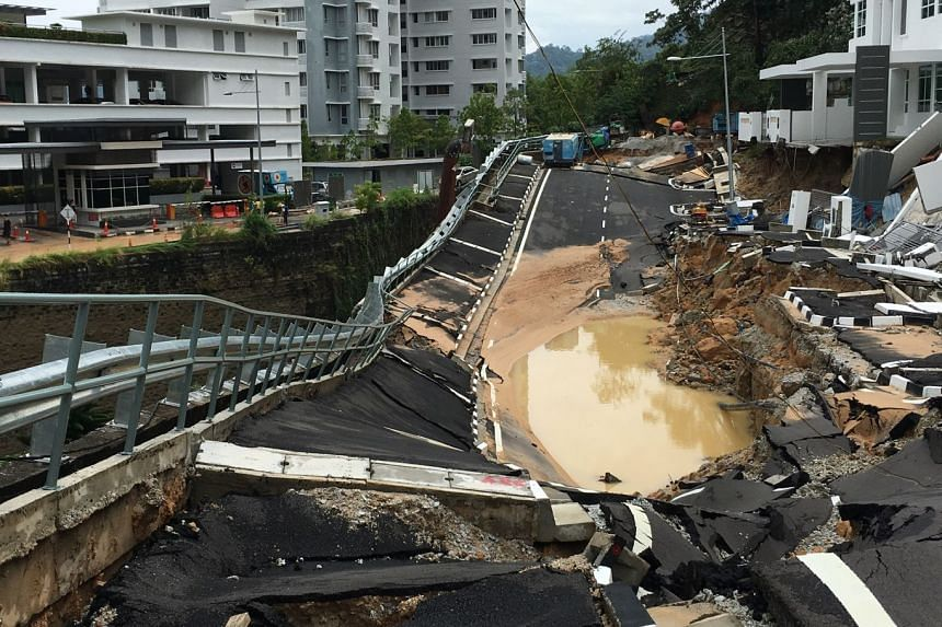 A sinkhole caused by a landslide in Tanjung Bungah. The state's worst floods caused more than 3,500 people to be evacuated from Penang, mostly on the mainland.