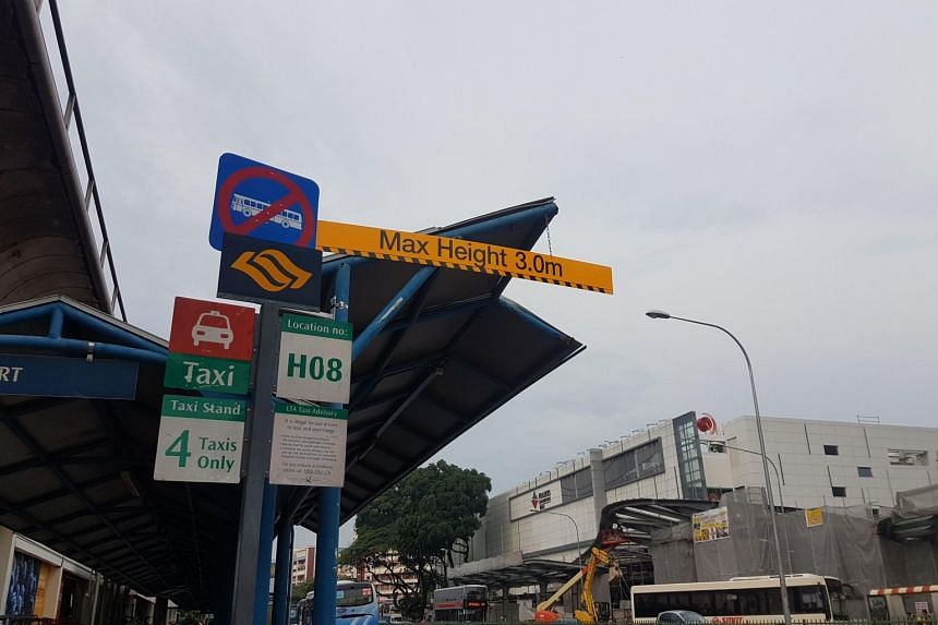 Enhanced signage at a sheltered taxi stand outside the Yishun MRT station, along Yishun Avenue 2, aimed at alerting bus drivers not to enter.