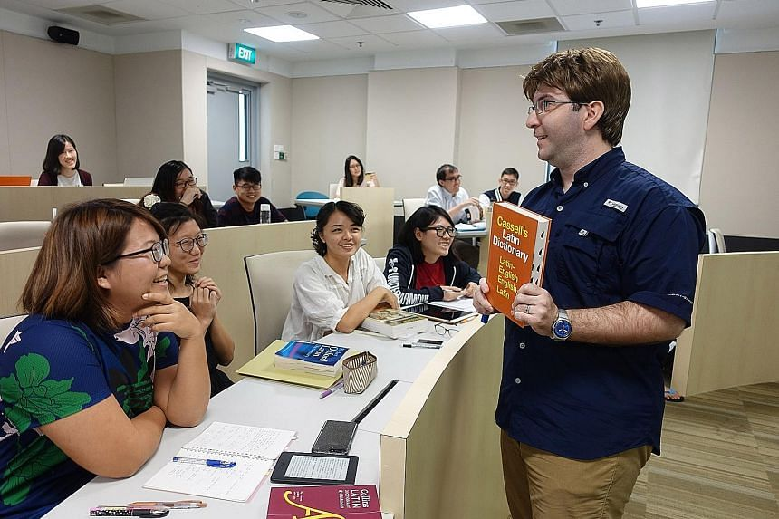 Dr Perono Cacciafoco Francesco teaching a Latin class at NTU. It is the first time any university here is offering Latin classes.