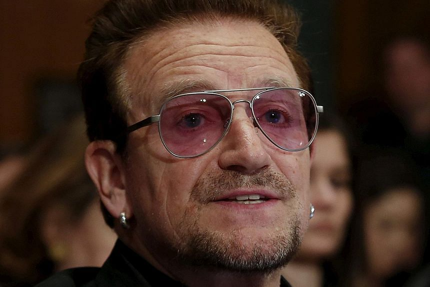 """(From left) US Commerce Secretary Wilbur Ross, U2 frontman Bono and Britain's Queen Elizabeth are among those whose names have cropped up in the """"Paradise Papers""""."""