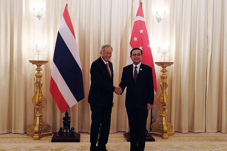 Defence Minister Ng Eng Hen meeting Thai Prime Minister Prayut Chan-o-cha at the Government House in Bangkok yesterday.