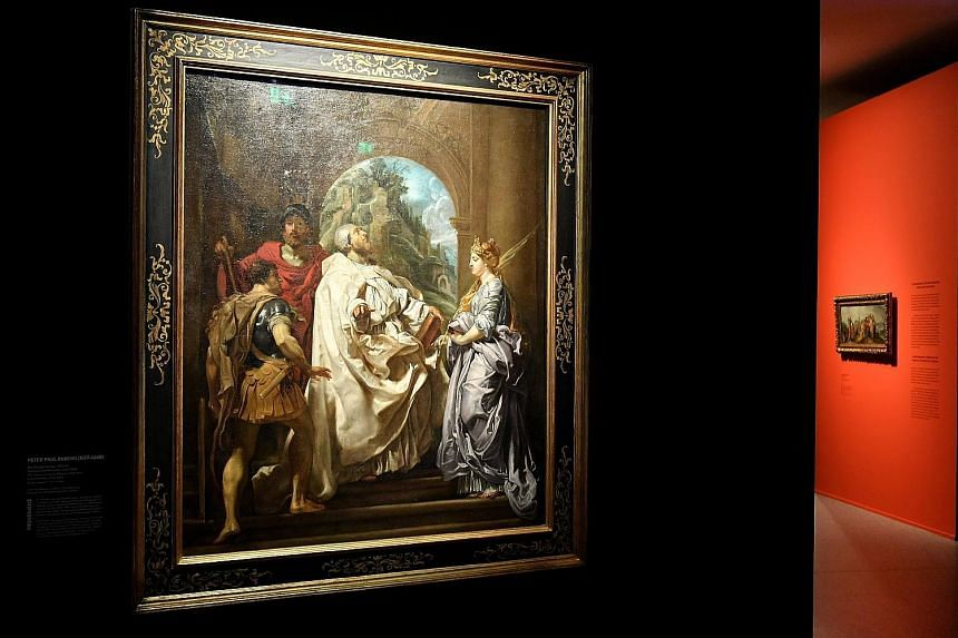 The Saints Gregory, Maurus, And Papianus And Domitilla by Flemish artist Peter Paul Rubens is on display in the exhibition at the Bundeskunsthalle in Bonn, Germany.