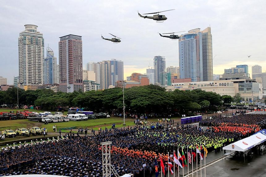 Philippine soldiers and police preparing for deployment as military helicopters flew overhead during a send-off ceremony in Manila on Sunday for the security forces for this week's Asean Summit. President Rodrigo Duterte will preside over the Asean S