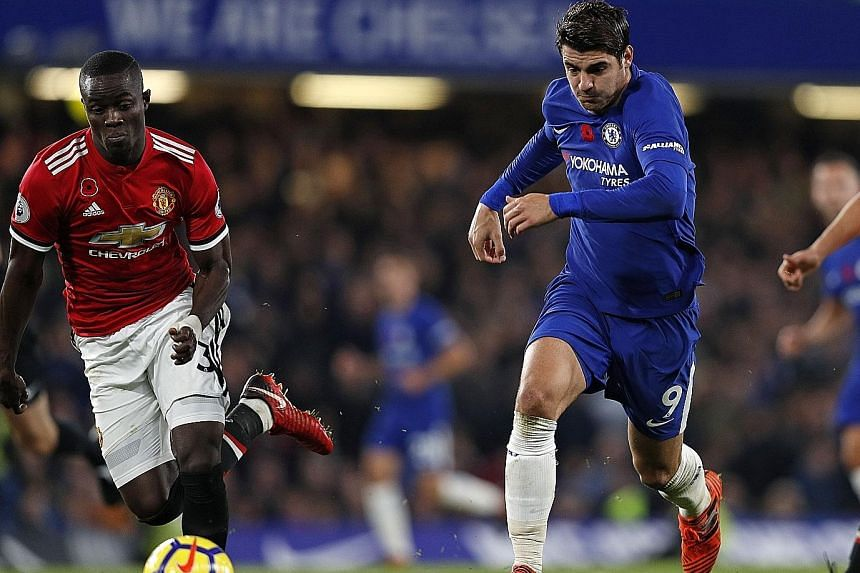 Chelsea striker Alvaro Morata (No. 9) retains possession as Eric Bailly of Manchester United attempts to match him for pace during the Blues' 1-0 victory at Stamford Bridge on Sunday. The Spaniard scored the only goal of the match, his first goal sin