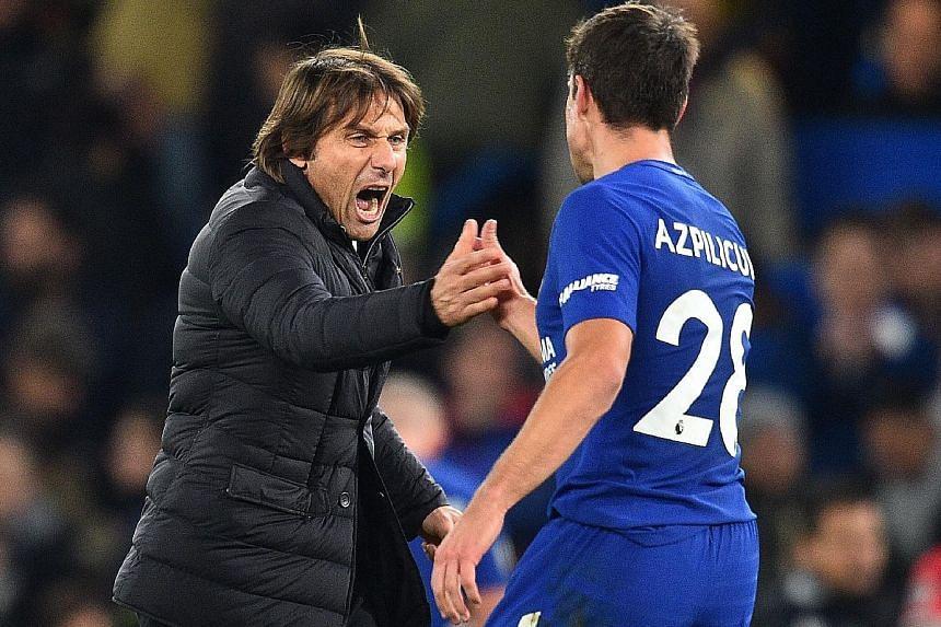 Chelsea coach Antonio Conte celebrating Sunday's 1-0 win over Manchester United with Spanish defender Cesar Azpilicueta.