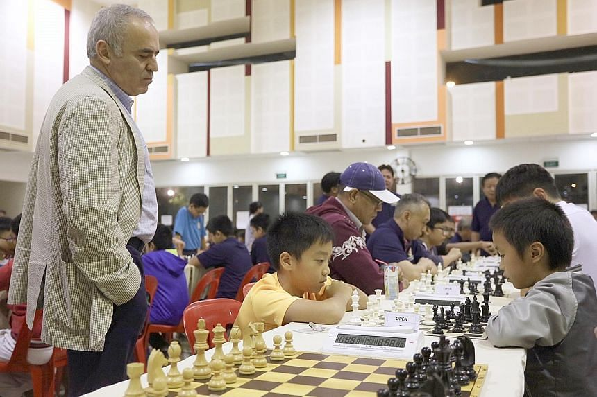 Former world chess champion Garry Kasparov observing games at the Punggol 21 Community Club. He said chess players' potential loss of energy is the mental equivalent of athletes' torn ligaments.