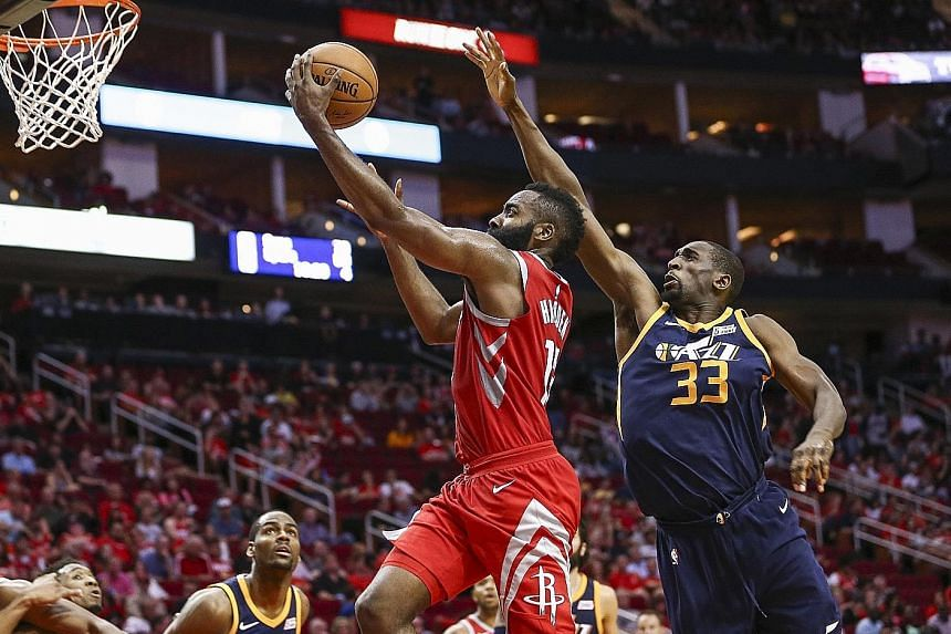 Houston Rockets' James Harden scoring on a lay-up against the Utah Jazz. The guard could not be contained, with 56 points in just 35 minutes.
