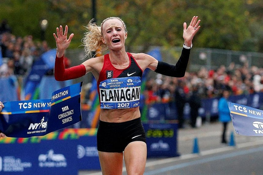 Shalane Flanagan, a 10,000m silver medallist at the 2008 Olympics, crossing the finish line to win the women's race at the New York City Marathon. It was the biggest marathon victory of the 36-year-old American's career.