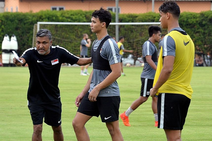 Singapore national football coach V. Sundram Moorthy conducting training at Geylang Lorong 12 yesterday. Thursday's Lebanon friendly will serve as the tune-up for Bahrain.