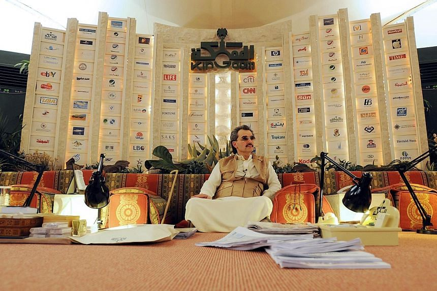 Saudi Prince Alwaleed bin Talal sitting inside his desert camp near Riyadh, Saudi Arabia, in 2010. He has sizeable stakes in Twitter, Lyft and Citigroup and has gone into business with some of the corporate world's biggest titans, including Mr Bill G