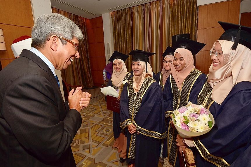 "Minister-in-charge of Muslim Affairs Yaacob Ibrahim speaking with graduates from the Al-Azhar University, in Cairo, on Sunday. He said Singapore needed strong religious leaders who ""possess an expansive worldview""."