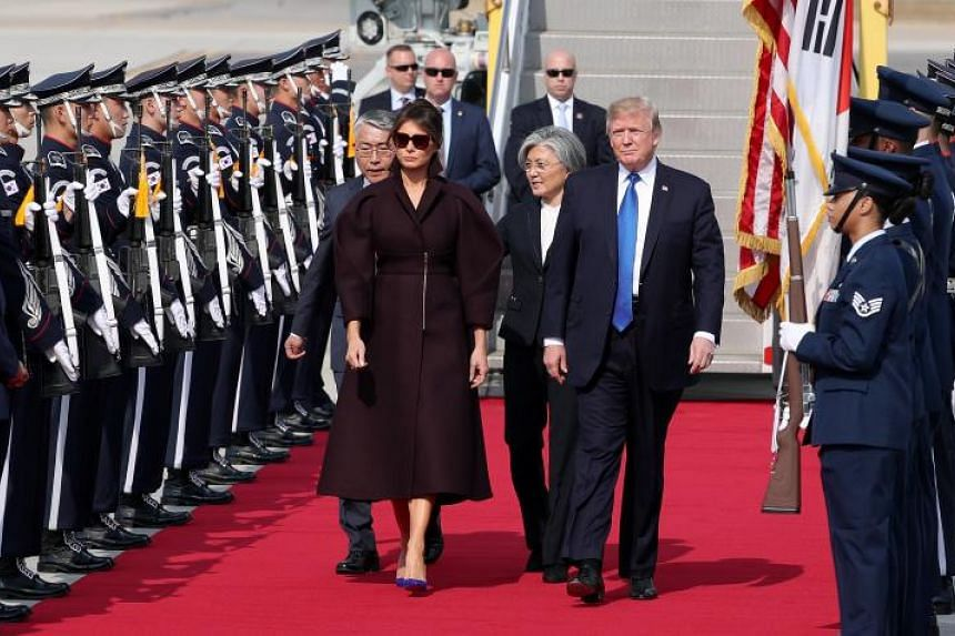 US President Donald Trump and First Lady Melania Trump are welcomed by South Korean Foreign Minister Kang Kyung Wha after arriving for a two-day state visit at Osan Air Base in Pyeongtaek  on Nov 7, 2017.
