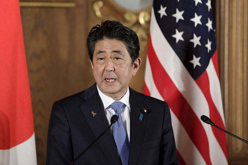 Japan's prime minister Shinzo Abe speaks during a news conference at Akasaka Palace in Tokyo.