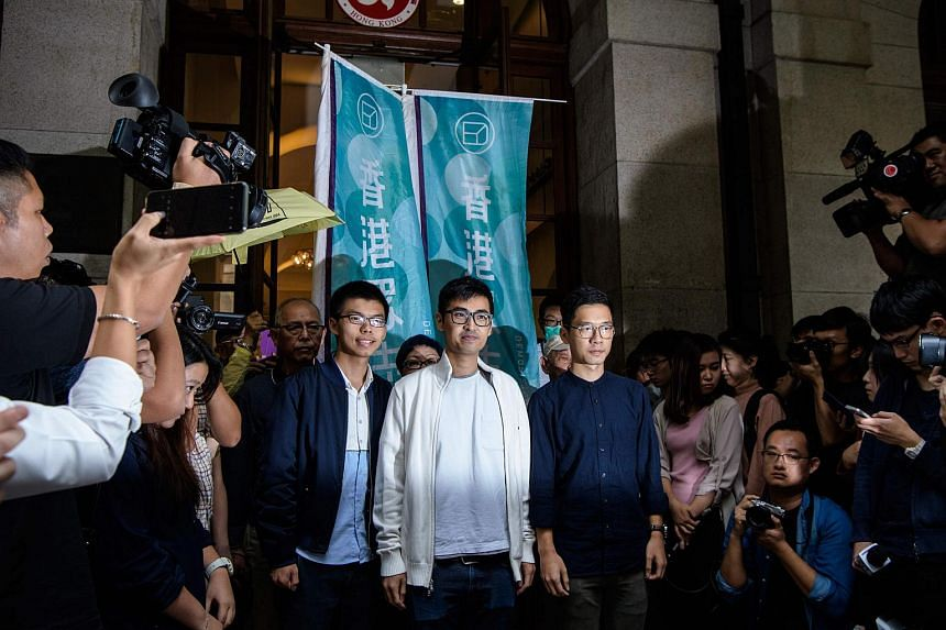 (Centre left to right) Bailed democracy activists Joshua Wong, Alex Chow and Nathan Law speak to the press outside the Court of Final Appeal on Nov 7, 2017.