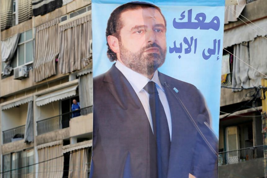 President Michel Aoun has said he will not decide whether to accept or reject Prime Minister Saad al-Hariri's resignation until he returns home from Saudi Arabia.