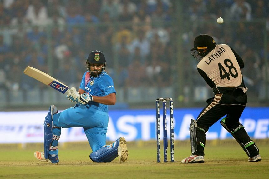 Indian batsman Rohit Sharma plays a shot during the first T20 cricket match between New Zealand and India.