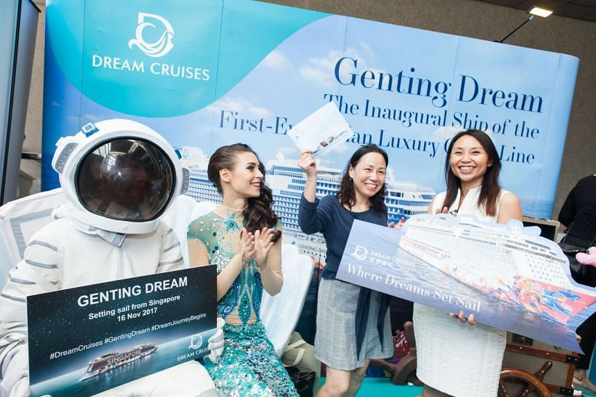At the Genting Dream cruise's roadshow, Ms Sally Tan (second from right), 58, won a 2D1N Genting Dream cruise. PHOTO: Dream Cruises