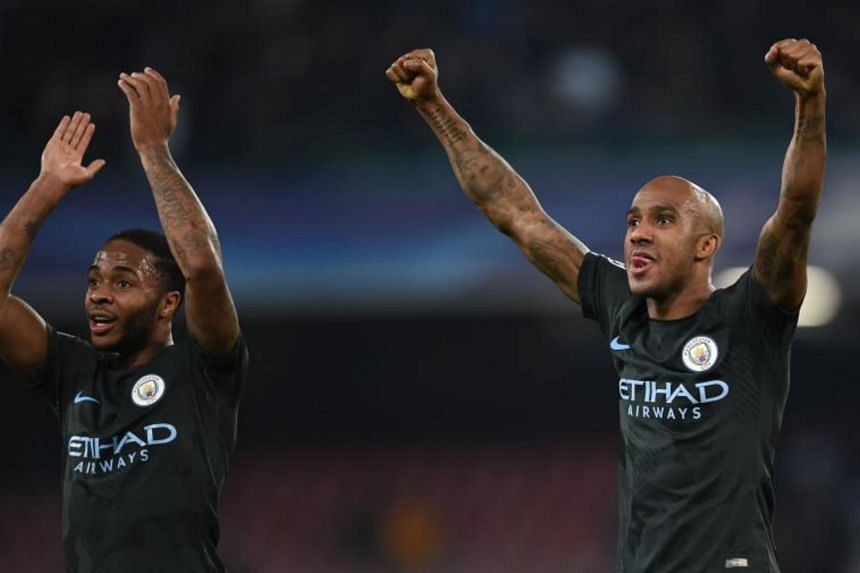 Manchester City's English midfielder Raheem Sterling (left) and Fabian Delph celebrate at the end of the UEFA Champions League football match at the San Paolo stadium in Naples, on Nov 1, 2017.