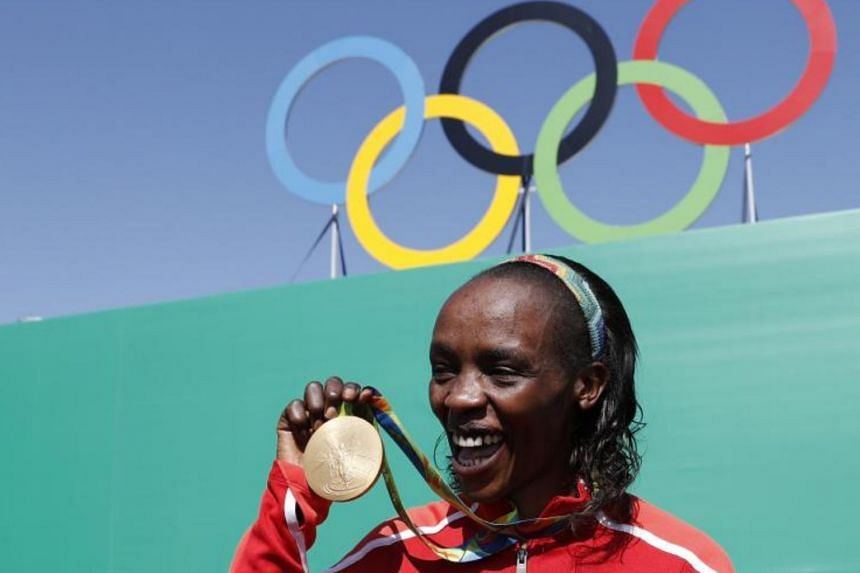 Gold medalist Jemima Sumgong after the podium ceremony for the Women's Marathon during the athletics event at the Rio 2016 Olympic Games at Sambodromo in Rio de Janeiro, on Aug 14, 2016.