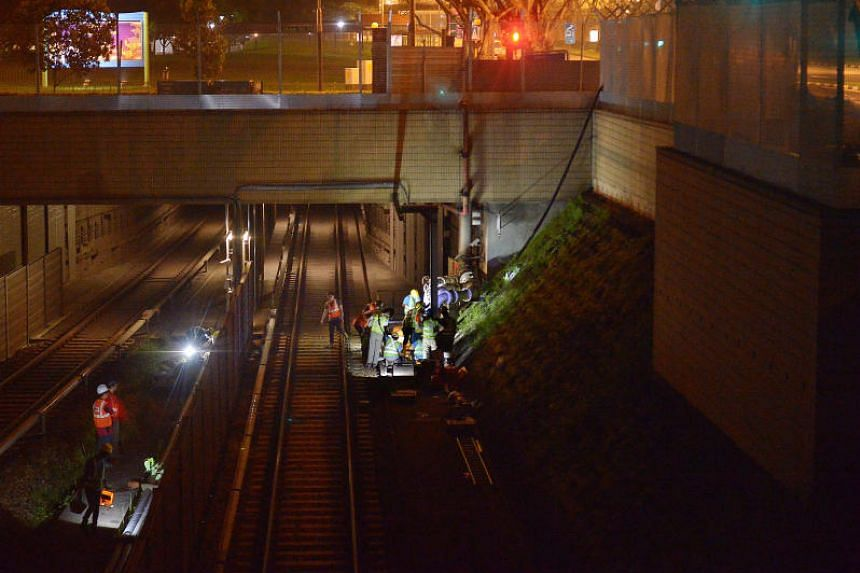 Operations to remove sludge from tunnels beneath the tracks were carried out at Bishan MRT station after the flooding.