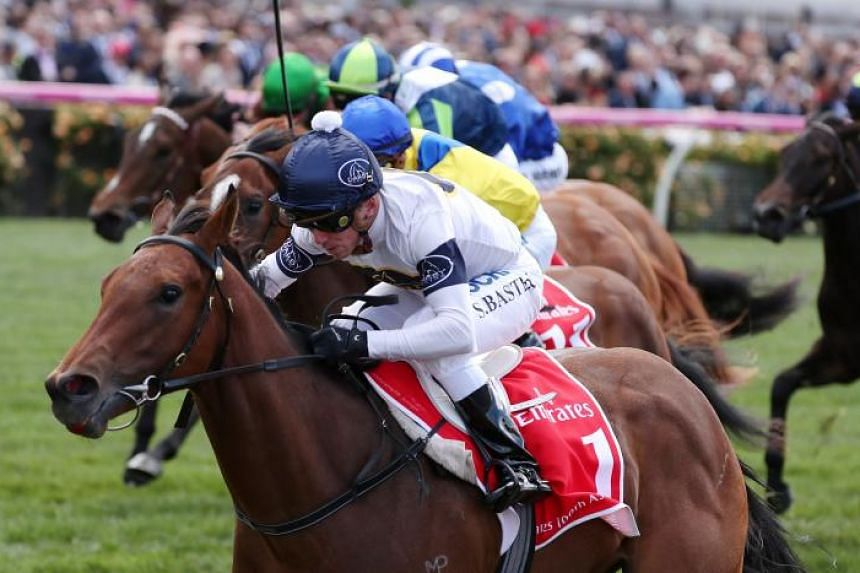 Stephen Baster rides Setsuna to victory in race 1 the Emirates 100th A380 Stakes, during Melbourne Cup.