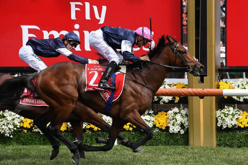 Rekindling, ridden by Corey Brown, wins the 157th version of the Melbourne Cup ahead of second-placed Johannes Vermeer at Flemington racecourse in Melbourne.