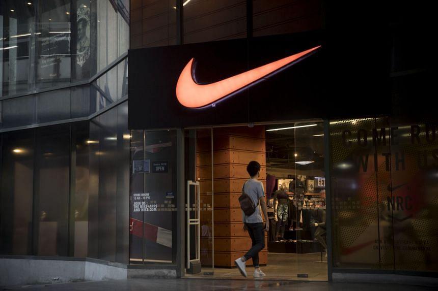 A man enters a Nike Inc. store in Bangkok, Thailand.