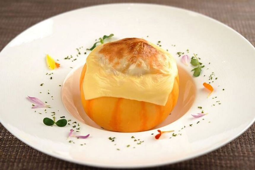 Inaniwa noodles baked in a creamy sauce in a baby pumpkin, draped with grilled cheese, is comfort food luxed up.