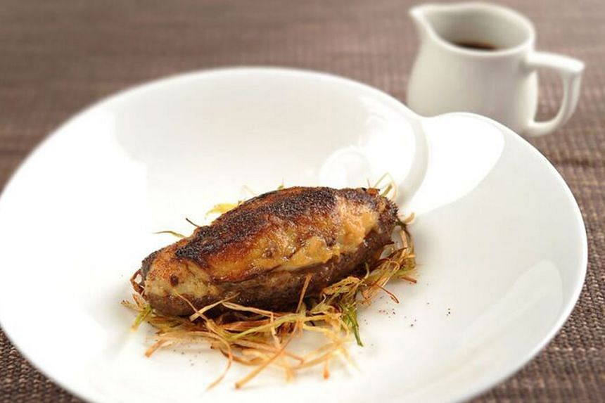 Braised sea cucumber stuffed with shrimp paste and foie gras in abalone sauce.