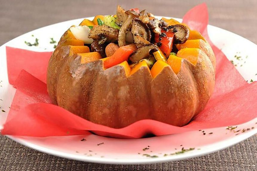Sauteed vegetables served in a pumpkin.