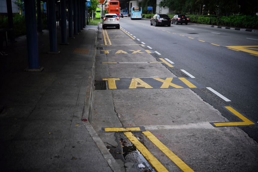 Left: Areas marked out for taxis at the taxi stand opposite VivoCity. Above: A height limit sign in bright yellow at the taxi stand outside Yishun MRT station.