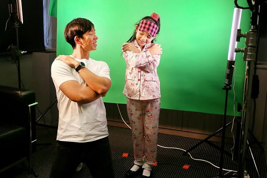 ChildAid 2017 performer Gisele Chiam, nine, working with assistant creative director Ben Tan, 28, on Monday to record a video that will be part of a multimedia segment of the show. Gisele, who will be acting and singing, is one of the four main leads