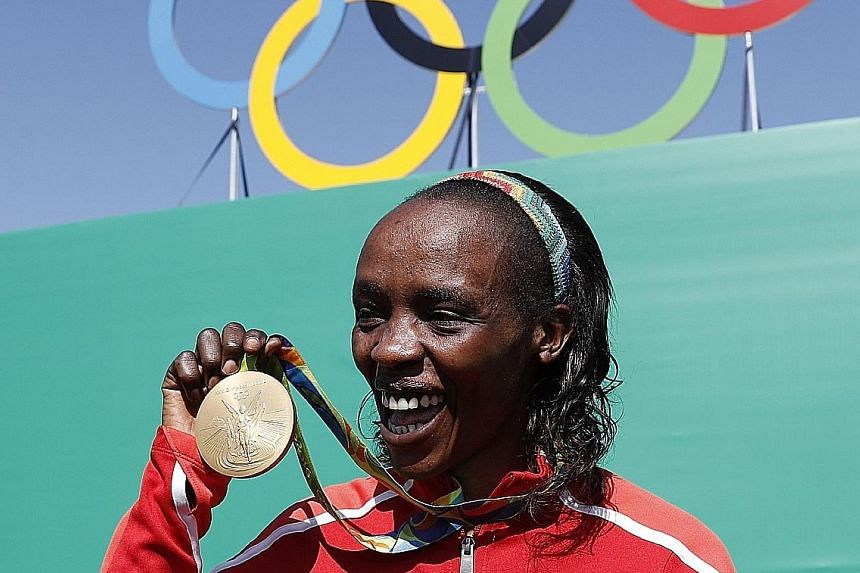 Kenyan Olympic gold medallist Jemima Sumgong celebrating after winning the marathon last August. She has been banned for four years.