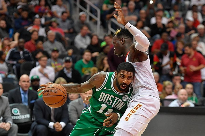 The Boston Celtics' Kyrie Irving getting past Atlanta Hawks guard Dennis Schroder at the Philips Arena on Monday. The All-Star guard has been on fire of late, helping the Celtics to a nine-game winning streak while averaging 22.3 points, 5.7 assists