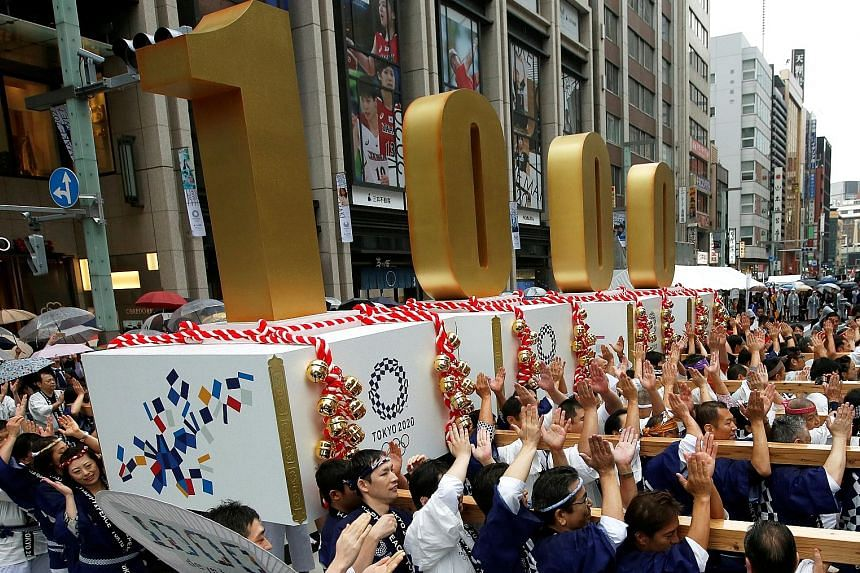 Japanese participants carrying portable floats bearing the number 1,000 at the Oct 28 countdown ceremony to mark 1,000 days until the commencement of the 2020 Olympic Games in Tokyo.