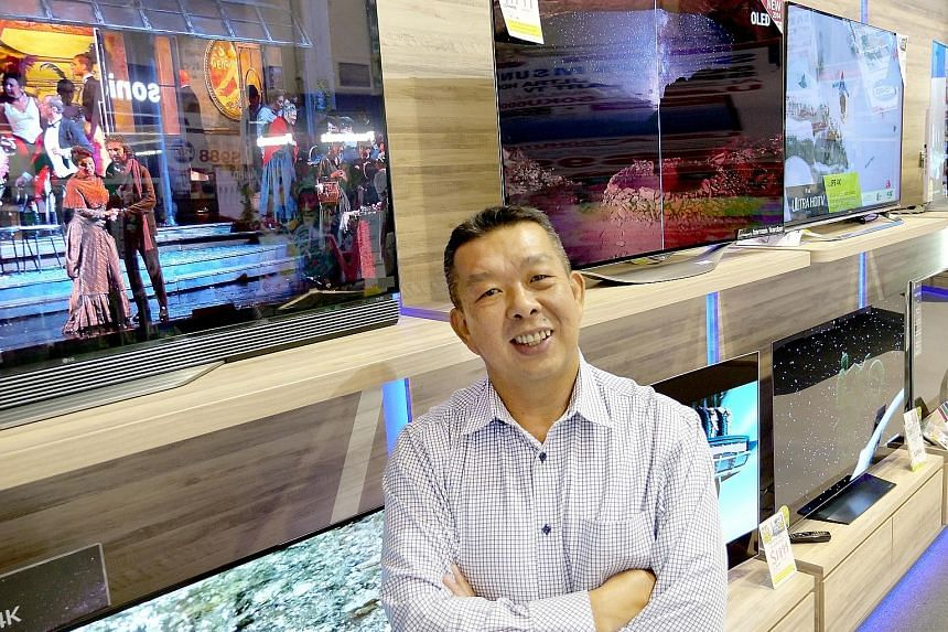 Audio House managing director Alvin Lee at the store in Bendemeer Road, which is the retailer's only outlet left. He believes the company is the first local consumer electronics retailer to go fully cashless, and said the move is expected to help it