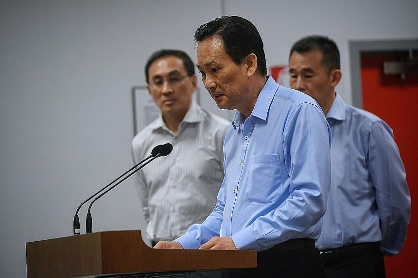 SMRT chairman Seah Moon Ming speaking at the Oct 16 media briefing on the MRT tunnel flooding incident. With him were SMRT CEO Desmond Kuek (far left) and SMRT Trains CEO Lee Ling Wee.