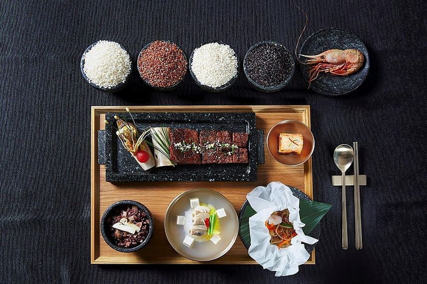 This photo provided by South Korea's presidential Blue House shows the meal to be served at the state dinner for Mr Donald Trump, which includes shrimp caught in the waters off Dokdo, the South Korea-controlled islands also claimed by Japan, which ca