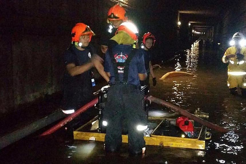 Singapore Civil Defence Force officers pumping water out of the flooded MRT tunnel last month.