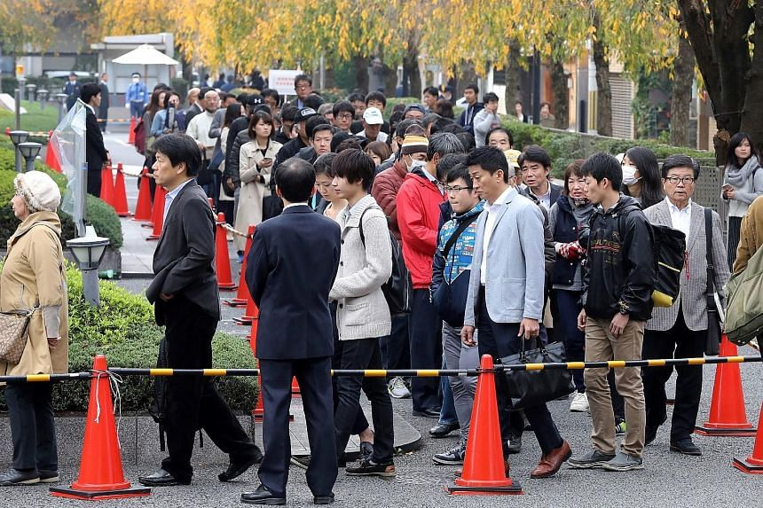 The prosecution said Chisako Kakehi pocketed at least 1 billion yen (S$12 million) from life insurance and inheritance payouts between 2007 and 2013. (Top) The case drew a crowd seeking to attend the judgment trial at the Kyoto district court yesterd