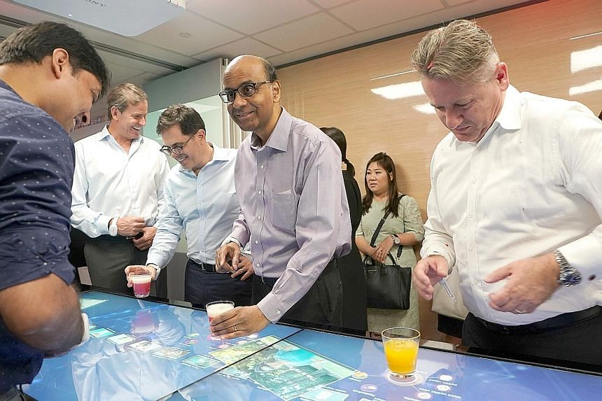Deputy Prime Minister Tharman Shanmugaratnam at a health and digital innovation showcase in Prudential Singapore's new office at Marina One.