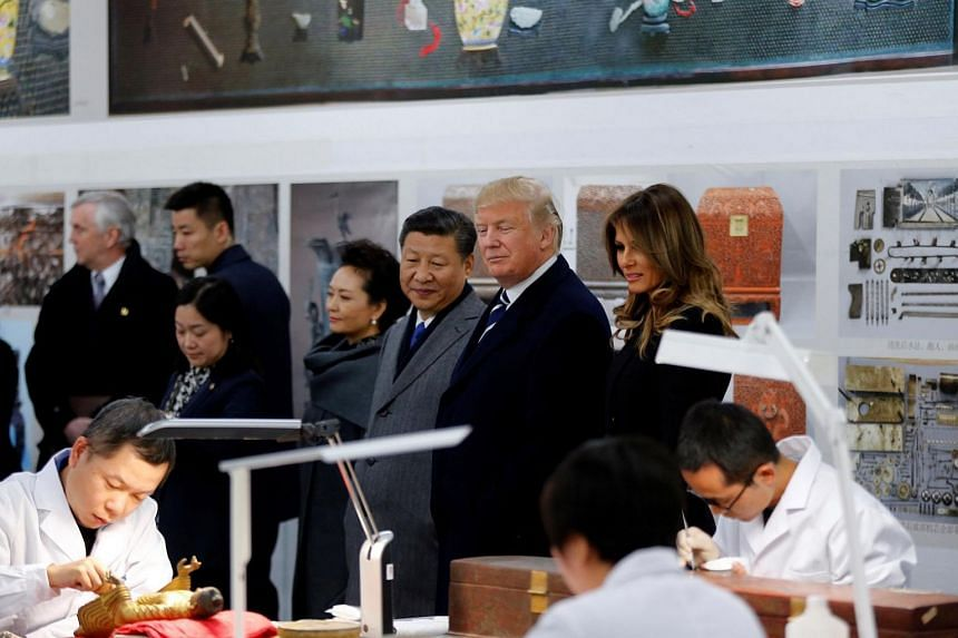 US President Donald Trump, US First Lady Melania Trump, Chinese President Xi Jinping and his wife Chinese First Lady Peng Liyuan tour the Conservation Scientific Laboratory of the Forbidden City in Beijing, China on Nov 8, 2017.