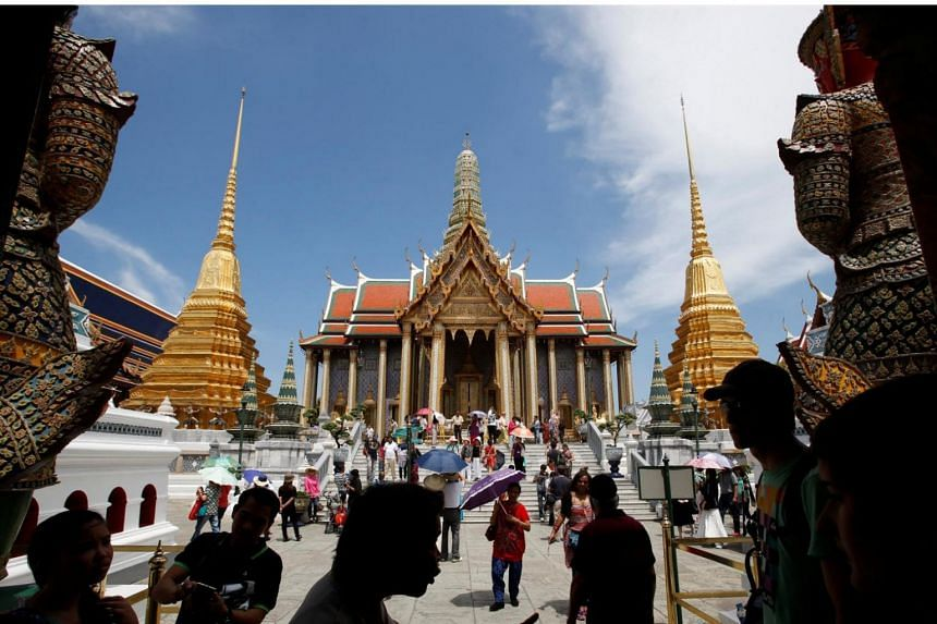 Tourists visit the Grand Palace in Bangkok, Thailand.
